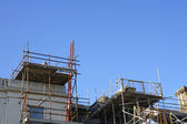 Scaffolding on outside of large house — Stock Photo