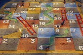 Large outdoor snakes and ladders game — Stock Photo