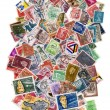 Постер, плакат: Large pile of postage stamps isolated on white