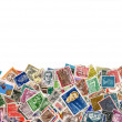 Stock Photo: Large amount of postage stamps isolated on white
