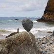 Stones balanced on a pebble beach — Stock Photo