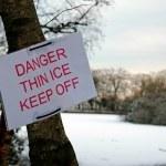 Danger thin ice sign — Stock Photo #30968461
