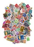Large pile of postage stamps isolated on white — Stock Photo