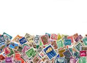 Large amount of postage stamps isolated on white — Stock Photo
