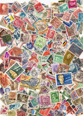 Large pile of postage stamps — Stock Photo