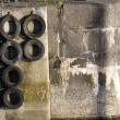 Harbour wall and tyres — Stock Photo #30971383