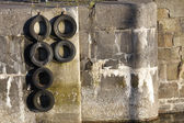 Harbour wall and tyres — Stock Photo