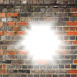 Light bursting through a brick wall — Stock Photo