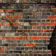 Cracked brick wall background — Stock Photo