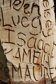 Names carved into wood — Stock Photo