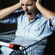 Guy in shopping cart screaming — Stock Photo #12443253