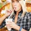 Girl drinking cocktail in a cafe — Stockfoto