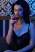 Retro girl wearing lingerie with whisky in her hand — 图库照片