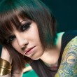 Stock Photo: Tattooed girl in studio