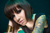 Tattooed girl in studio — Stock Photo