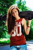 Urban girl with longboard — Stock Photo