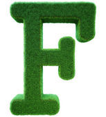 Letter of F from a green grass. Alphabet from a grass. Isolated — Stock Photo