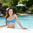 Sexy tropical woman at pool — Stock Photo