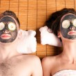 Stock Photo: Couples retreat facial mask spa
