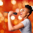 Stock Photo: Singing kareoke womwith microphone
