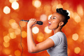 Singing kareoke woman with microphone — Stock Photo