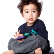 Cute boy sitting with mobile device — Stock Photo
