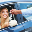 Royalty-Free Stock Photo: So pleased with her new sedan