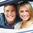 Enjoying their new car to the fullest - Stock Photo
