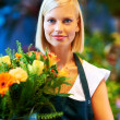 Royalty-Free Stock Photo: She puts passion into her flower arrangements