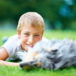 Every boy needs a dog growing up - Stock Photo