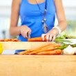 Taking care when chopping her veggies - Stock Photo