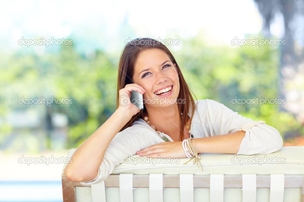 Pretty young woman on her cellphone with a laugh — Stock Photo #13598717