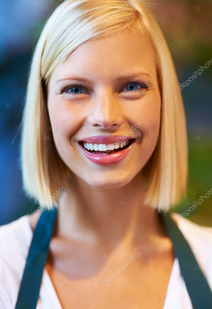 Portrait of a pretty young flower shop assistant  Stock Photo #13599500