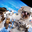 Spacewalking at the International Space Station - Stock Photo