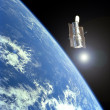 A satellite orbiting around Earth - Stock Photo