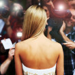 Everyone wants a piece of her - Celebrity Lifestyle - Stock Photo