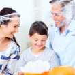 Enjoying Halloween as a family - Stock Photo