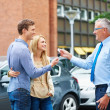 Royalty-Free Stock Photo: Buying their first car together