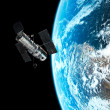 The Hubble telescope's view of the Earth during orbit - Stock Photo