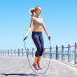 Skipping is a great full body work out - Stock Photo