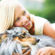 Her dog brings out her softer side - Stock Photo