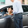 Royalty-Free Stock Photo: He\'s an experienced car salesman