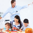 Happily helping create Halloween fun - Stock Photo