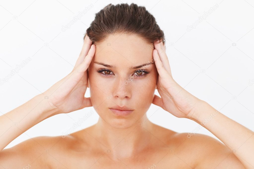 Serious young woman touching her head while isolated on white - closeup — Stock Photo #13601118