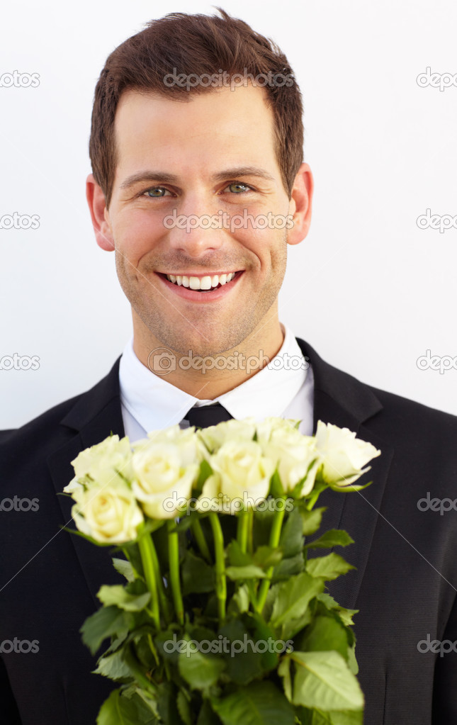 Attractive suitor presents roses in an attempt to woo  Stock Photo #13602771