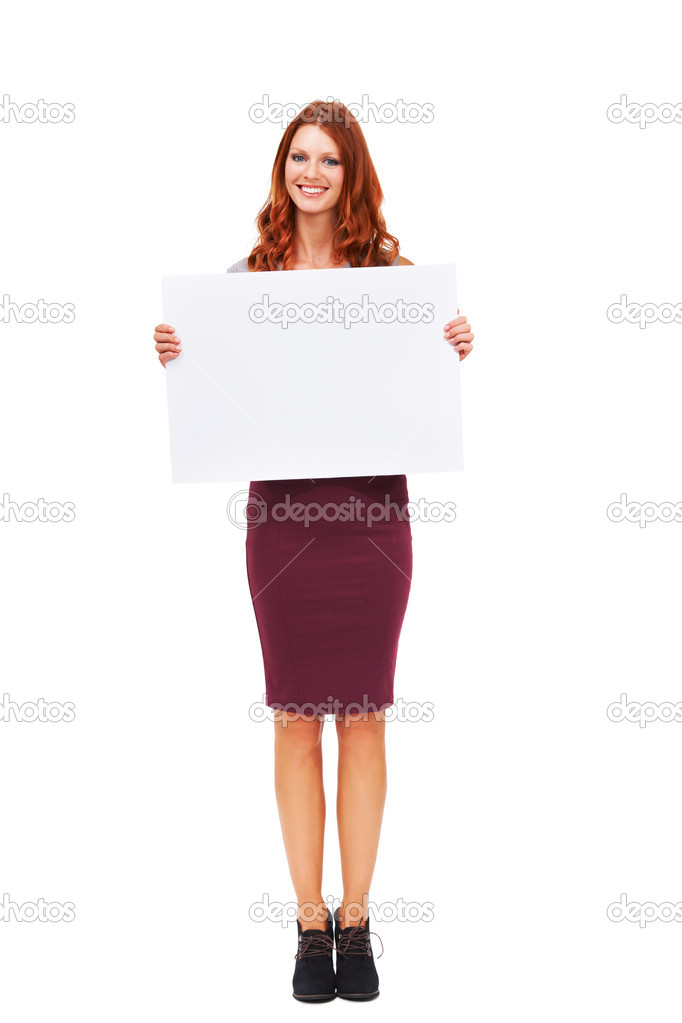 Portrait of an attractive young woman holding a sign isolated on white - Copyspace  Stock fotografie #13602928