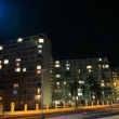 Residential blocks with flickering lights - Stock Photo