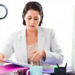Businesswoman working hard - Stock Photo