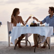 Royalty-Free Stock Photo: Attractive couple enjoying dinner at the beach
