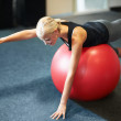 Working on balance and strengthening her core - Stockfoto